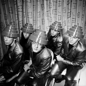 """DEVO."" Art Direction: David Allen. Backdrop silkscreen: Phyllis Cohen. Photo: Jules Bates."