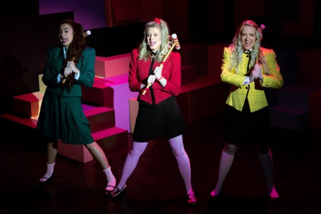 Tia Karaplis as Heather Duke, from left, Kayla Heichel as Heather Chandler and Amy Kohmescher as Heather McNamara. PHOTO | Patrick R. Murphy/PRM Digital Productions