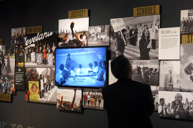 """Kenneth B. Liffman, a member of the Maltz Museum board of trustees, inspects the Cleveland section of """"This Light of Ours.""""   Photo / Maltz Museum of Jewish Heritage"""
