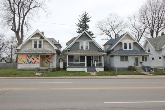 An abandoned, dilapidated house on Detroit Avenue in Toledo stands out thanks to a Toledo Arts Commission project in which Lanese led a team of volunteers in sprucing up the building. The project was part of a larger, creative placemaking initiative.