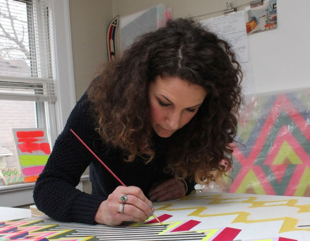 """Natalie Lanese paints in parts of the initial design for """"Cavern,"""" which was later installed on a much larger scale, at her home studio."""