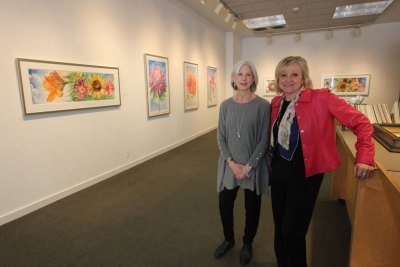 """Gallery director Marcia Hall, left, and office manager Olga Merela inside Bonfoey Gallery during its spring exhibition, """"George Mauersberger: Modern Botanicals."""""""