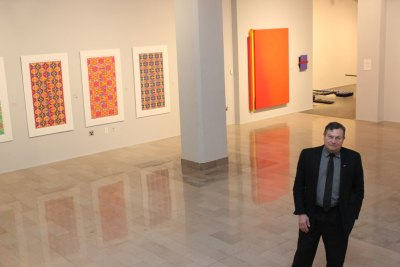 """Director and chief curator Robert Thurmer inside The Galleries of CSU during its spring exhibition, """"The Curious Case of Color."""""""