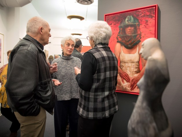 """From left, George Roby talks with Sally Zarney and Ellie Wren during the """"It's Elemental: Fire & Water"""" exhibit, which was on view in early 2017 at the Valley Art Center. Photo by Valley Art Center / Michael Steinberg"""
