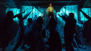 """Daryl Kelley as Bobby Strong, center, and the """"Urinetown"""" ensemble. Photo / Andy Dudik"""
