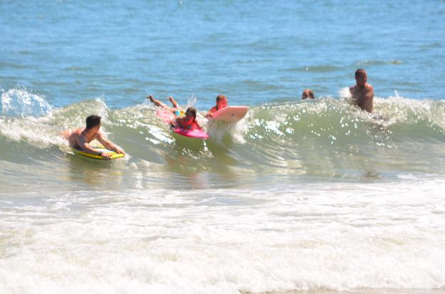 Sean and the girls riding a wave!