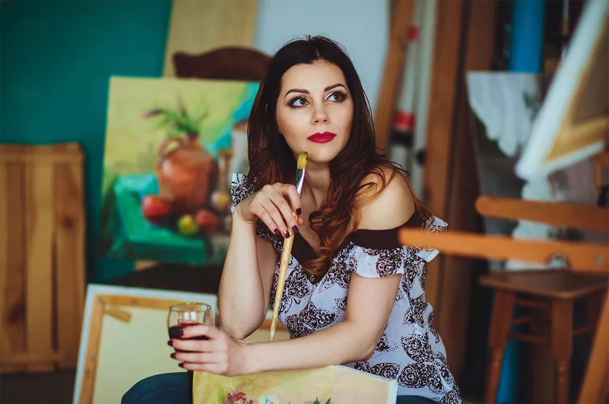 Woman Drinking Wine While Painting
