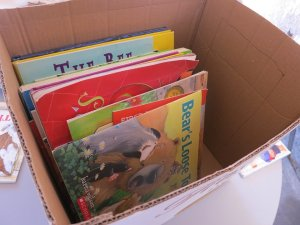 A moving box containing books for children