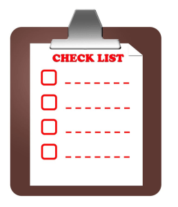 the red-lettered checklist with boxes to be checked and space tolist your belongings when packing