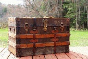 a big, heavy wooden trunk