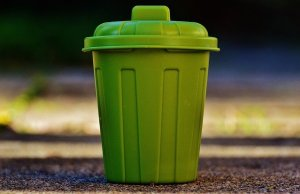 Small green garbage can.