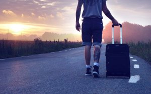 Man with a suitcase, moving to NYC as a student
