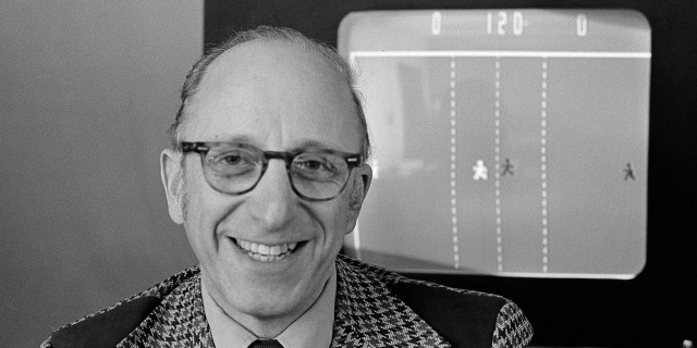 Ralph Baer an engineer for Sanders Associates, Inc., of Nashua, New Hampshire, watches his TV hockey game in this double exposure, February 3, 1977. Baer is responsible for millions of Americans frantically twisting knobs of frustration to move paddles of light in pursuit of targets of futility across their TV screens. (AP Photo)