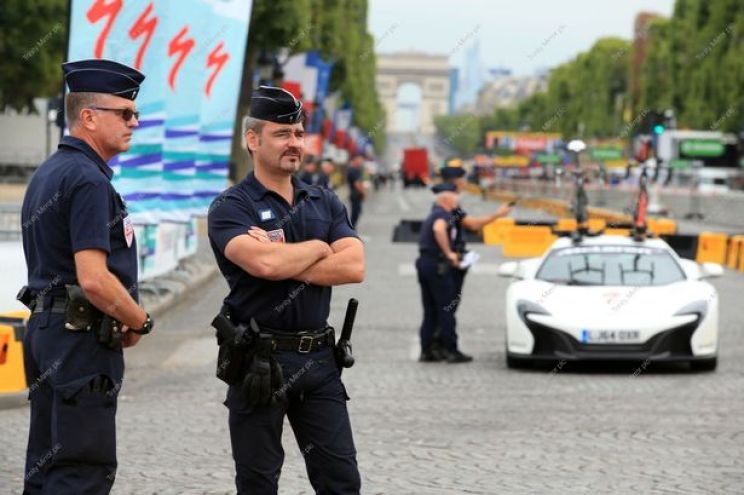 Police-on-the-Champs-Elysees-in-Paris-France-where-the-final-stage-of-the-Tour-de-France