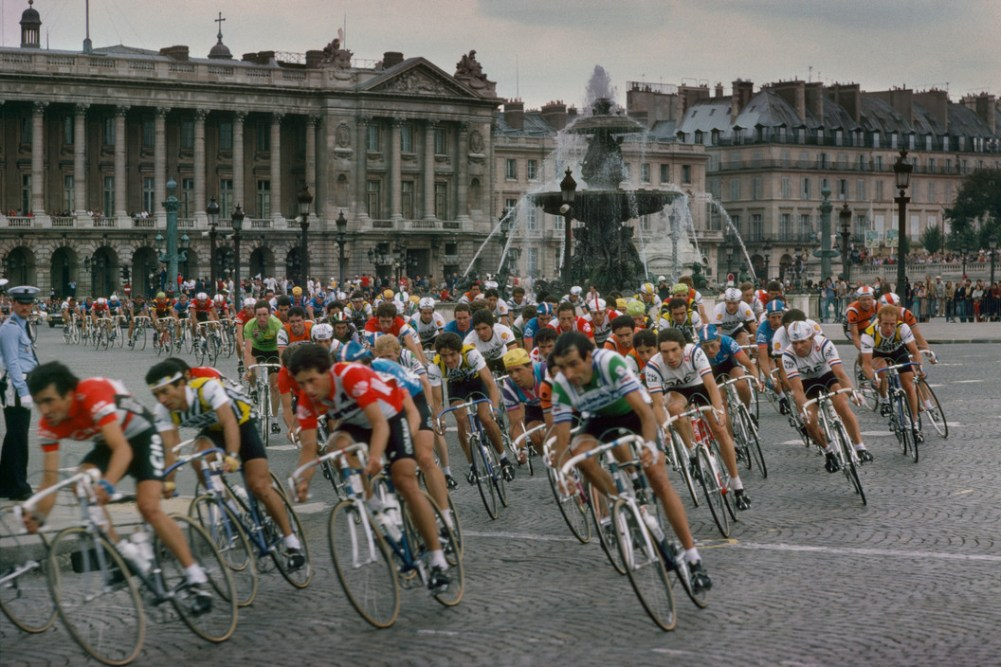 Tour de France 1982. The peloton sweeps into Paris and onto the Place de la Concorde past the Hotel Crillon. France. 1982.