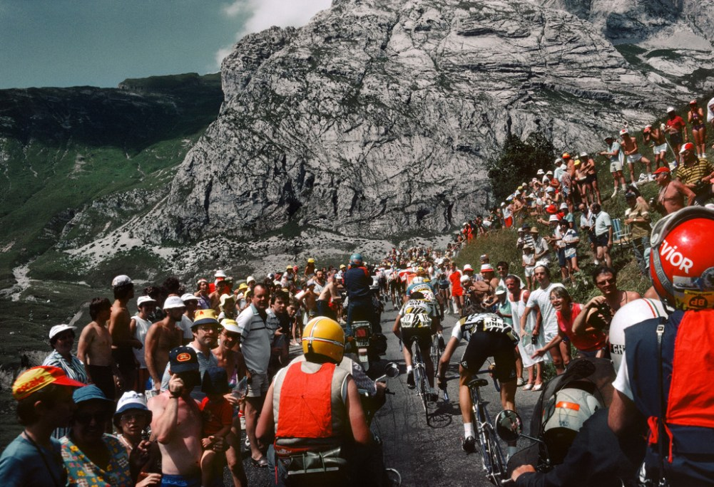 Tour de France 1982. Two of the Renault-Elf team struggle at the back of the group. France. 1982.