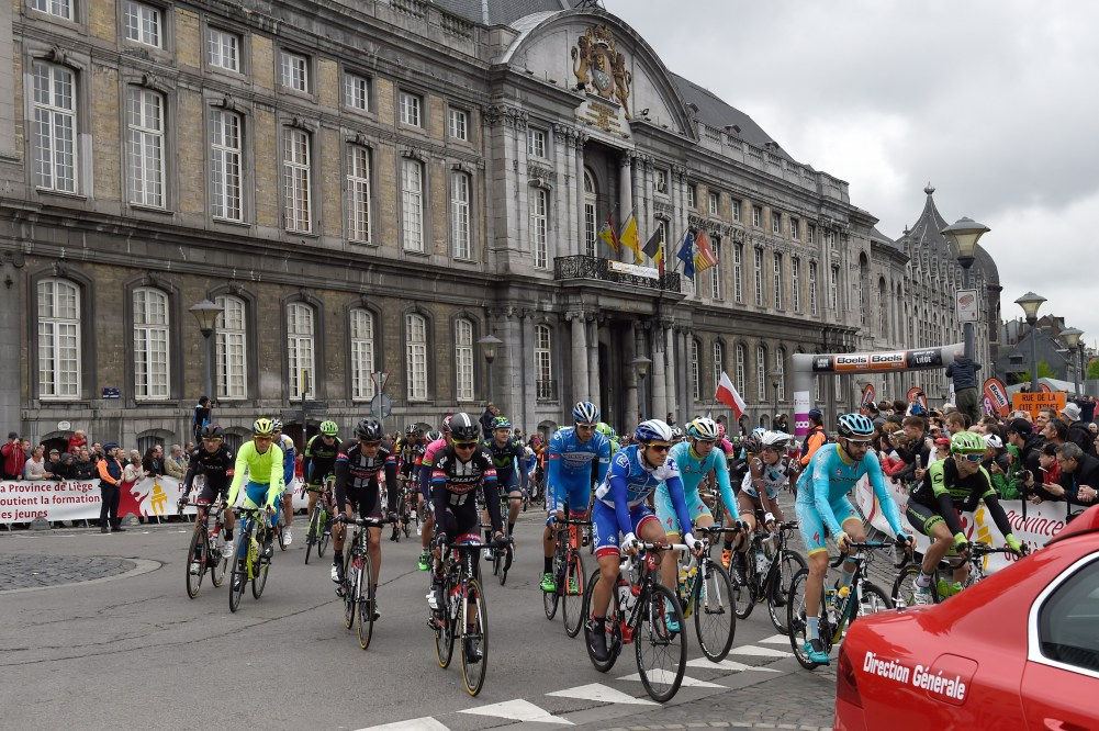 Riders cycle past the former palace of the Prince-Bishops of Liege as they take the start of the 101st Liege-Bastogne-Liege one-day classic cycling race on April 26, 2015 in Liege. AFP PHOTO / ERIC EFEFERBERG (Photo credit should read ERIC FEFERBERG/AFP/Getty Images)
