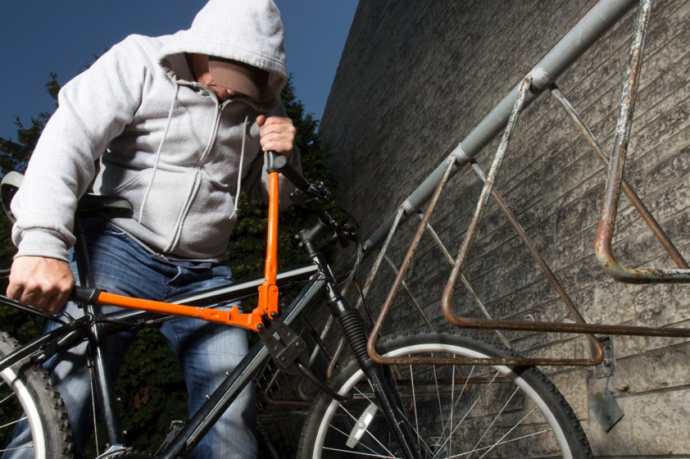 A royalty free image from the sports and recreation industry of a bike theft in progress