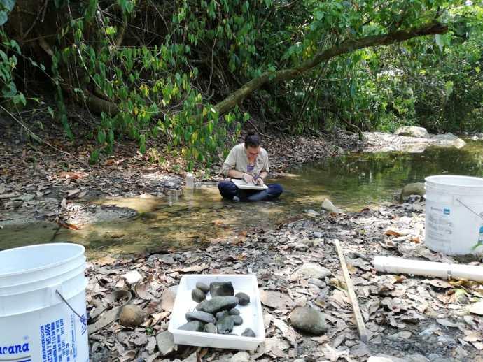Keysa bug picking in a Chiapas stream