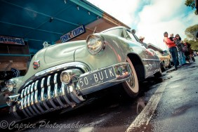 1950 Buick slammed with big toothy grin
