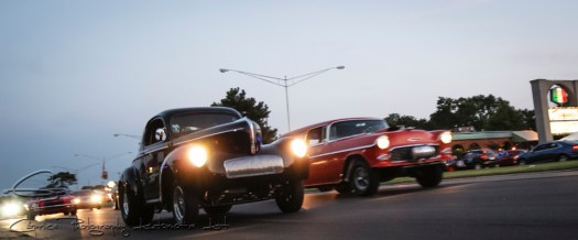 A scene reminiscent of Woodward Boulevard in the 1950s as a 1940 Willys looks to be taking on a 1955 Chevy Nomad gasser in a straight line run from light to light.