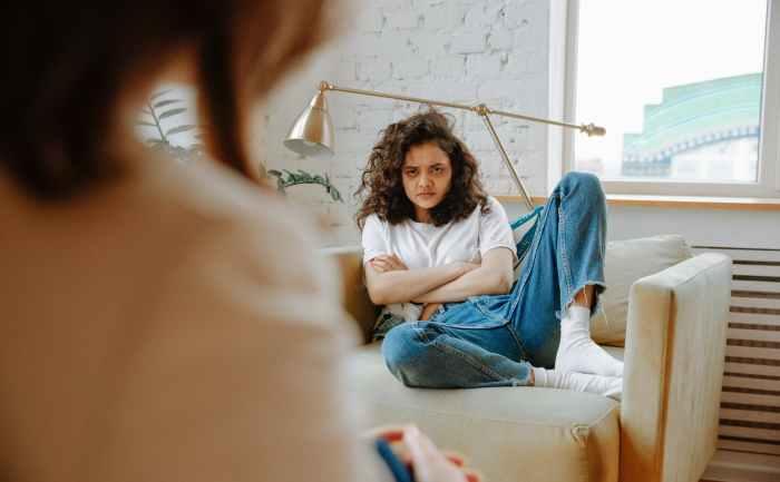upset woman listening to therapist