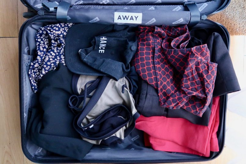 capsule-suitcase-how-to-pack-hat