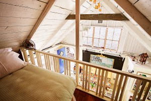 Sleeping loft with view of living room