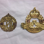 Back of the two BSC cap badges. Both were made by W. SCULLY in MONTREAL, Canada. Note that the lugs have been cut off of the larger badge.  - Colin M Stevens' Collection
