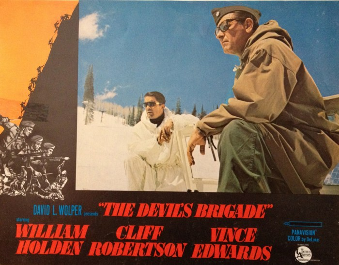 Movie lobby card showin two soldiers in the snow. Devil's Brigade movie lobby card