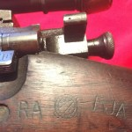 """M1903A4 Left side showing the markings """"RA (for Remington Arms, not Raritan Arsenal), Crossed cannons and FJA (Frank J. Atwood)"""