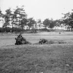 Two snipers demonstrate - left is prone, right is low silhouette Hawkins position 21st Army Group sniping school near Eindhoven, 15 October 1944. © IWM (B 10972)