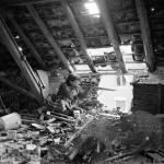 "Sniper in attic British. ""C"" Company 5 Battalion, Black Watch 51 Highland Division, Gennep Netherlands . Posed photo as position is unsafe. By 5 AF&PU © IWM (B 14628)"