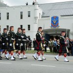 23 - The lead rifle company passes the Reviewing Stand and entrance to the Seaforth Armoury.