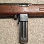 Reising Model 50 Sub-machine Gun - Right side showing 12-round magazine.