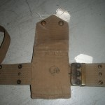 1914 MILLS webbing set for Colt 1911 Commercial pistol, one of 5,000 purchased by Canada in 1914, serial number C13085. Back view of the magazine pouch showing the Canadian issue mark C/|"|150|150|?|b6758e4596d6f7c29d81b0d4cd015579|False|UNLIKELY|0.3203006982803345