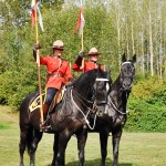 Two Mounties on horseback.
