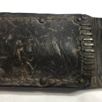 Mouth of knife scabbard.
