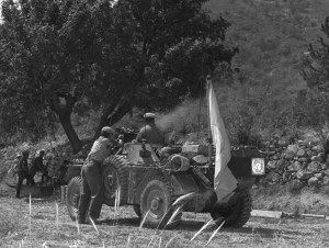 Ferret 54-82522  returning fire when ambushed during a patrol in Cyprus, 1964. (ref. CYP64-56-1 CFJIC CD No 1 ) Detail.