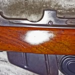 """Rifle serial number J-5550-16 and has a mid-war 2-position """"L"""" backsight. Left side with the action in the stock."""