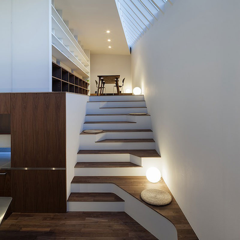 Asymmetric Staircase Incorporates Sitting Areas  Captivatist