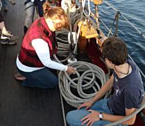 Marie using the Ballantine Coil to coil one of the halyards.