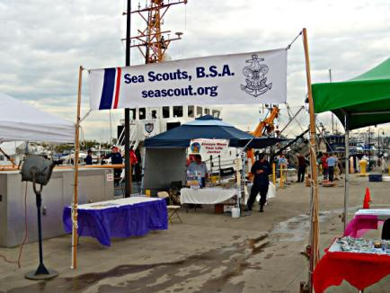 U.S. Coast Guard Cutter Blue Shark in the background, behind the Coast Guard Auxiliary Booth, that looked like part of the Sea Scouts.