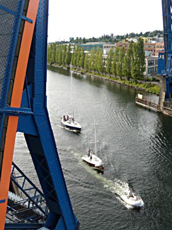Sailboats going through an opening at the Fremont Bridge