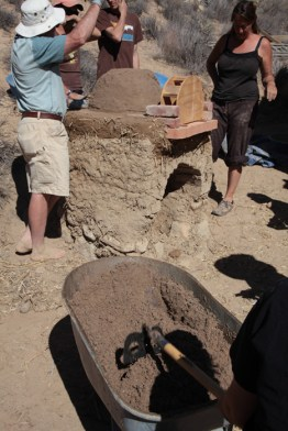 Shaping the wet-sand form.