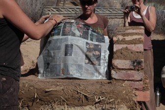Using newspaper to determine when to stop clearing sand