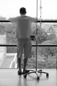 A closer look at Dave hooked up to his drugs... looking out at the world from our penthouse suite.