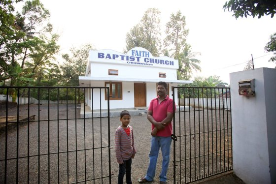 Ashland and Matthew in front of the church they donated the land for.