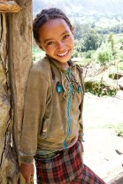 Precious girl in the countryside of Ethiopia, her smile was in response to my complimenting the lovely flowers on her shirt