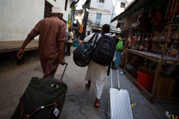 My Rimowa being pulled the the alleyways on a unexpected adventure of the coast of Africa in Zanzibar